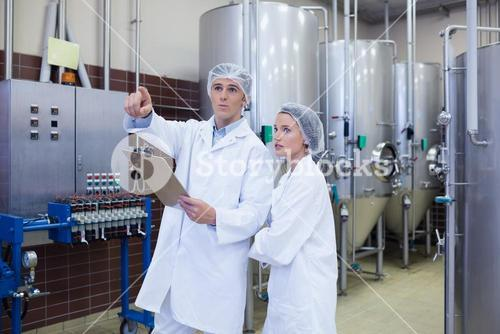 Man pointing at something to his colleague