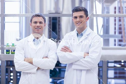 Scientist team smiling at camera with arms crossed