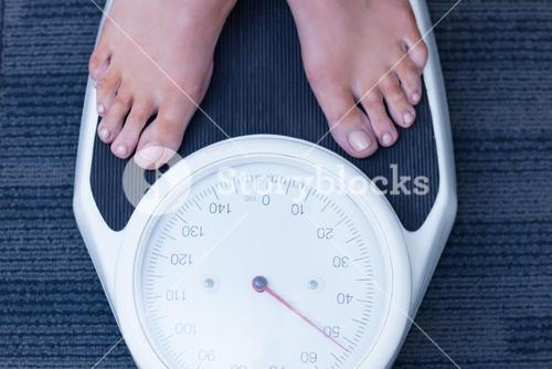 Close up of a woman standing on the scales