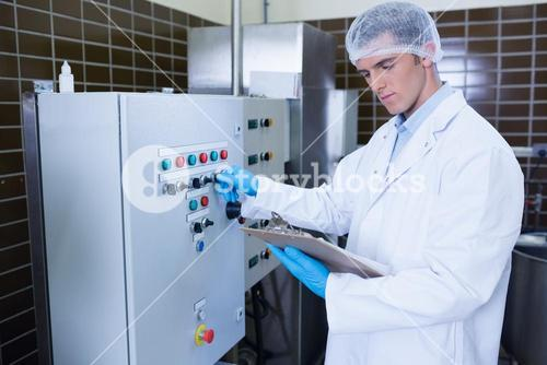 Focused biologist with safety gloves holding clipboard