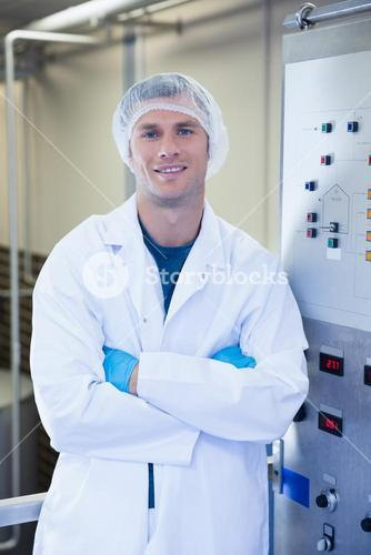 Portrait of a smiling scientist with arms crossed
