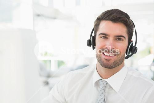 Handsome businessman with headset interacting