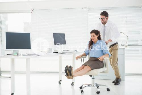 Happy team playing together with swivel chair