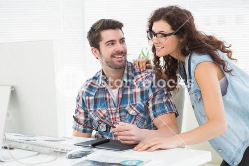 Cheerful partners using computer together