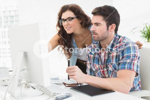 Business people using computer and digitizer