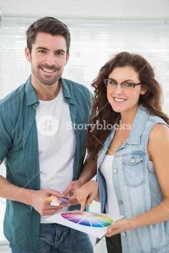Portrait of smiling customers with colour wheel