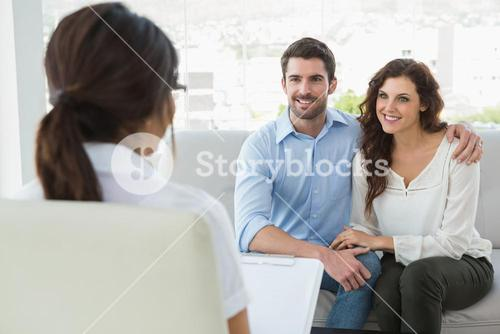 Psychiatrist listening her smiling patients