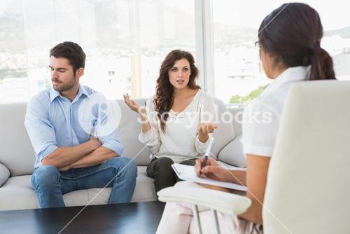Couple quarreling in front of their therapist
