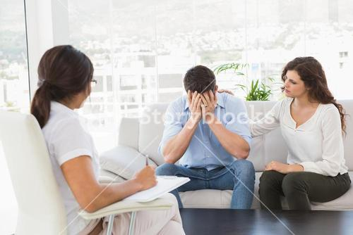 Depressed couple talking with their therapist