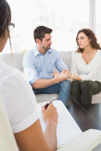Couple talking with their psychologist