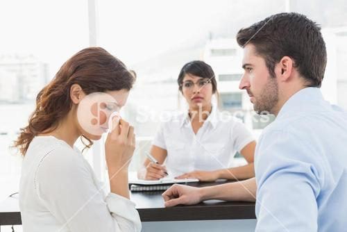 Troubled couple talking with their therapist