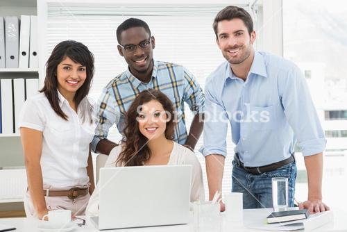 Smiling coworkers looking at camera