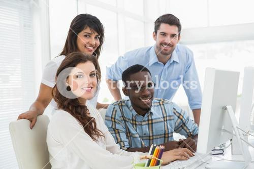 Smiling business people using computer