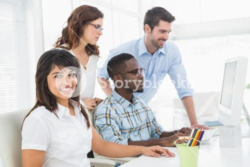 Teamwork using computer monitor together