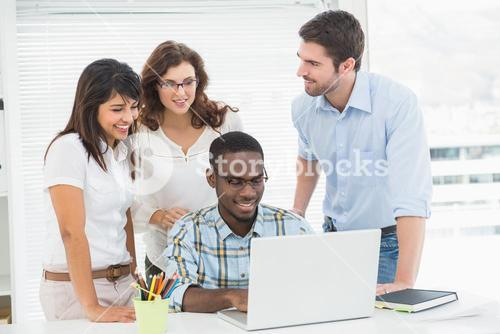 Partnership working together with laptop