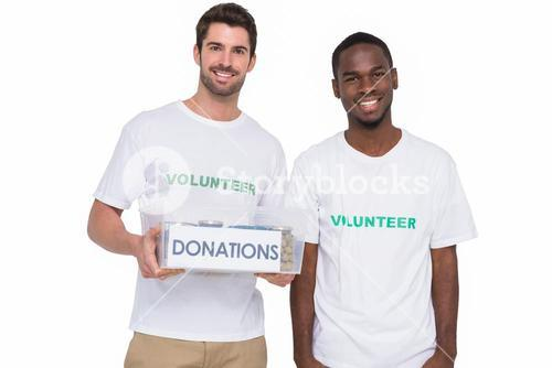 Portrait of smiling men participating at charity