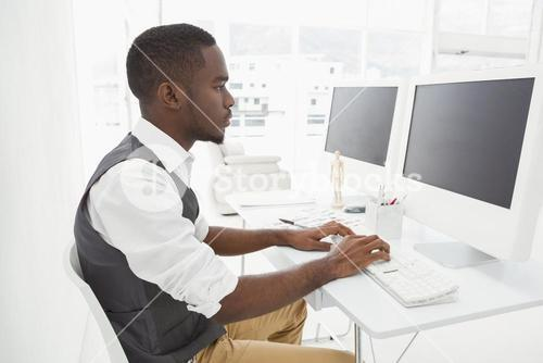 Classy businessman concentrating and using computer
