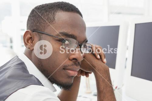 Businessman with glasses and hands joined
