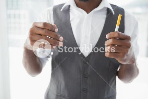 Casual businessman holding cigarettes