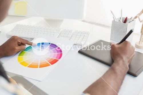 Businessman using colour sample and digitizer
