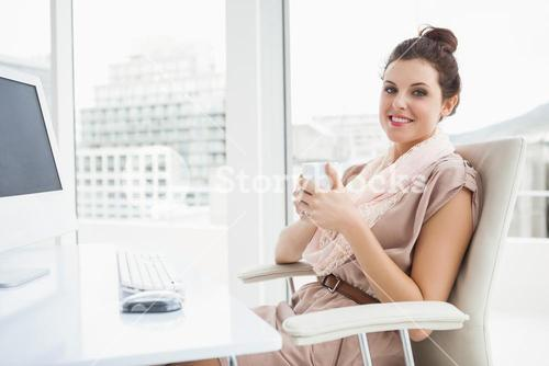 Relaxed businesswoman holding hot drink