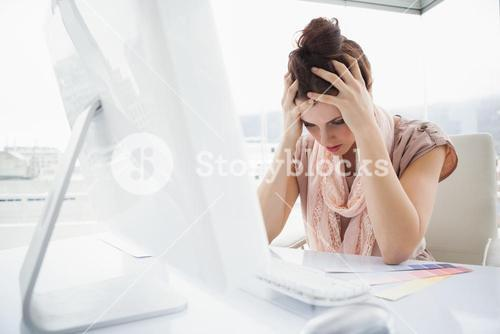 Exhausted businesswoman working with colour sample