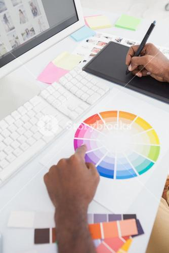 Designer using colour wheel and digitizer