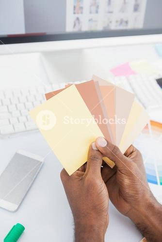 Designer holding colour swatch and choosing