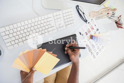 Designer using digitizer and colour wheel