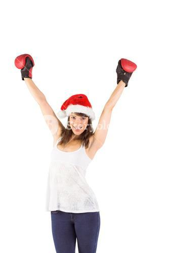 Festive brunette cheering with boxing gloves