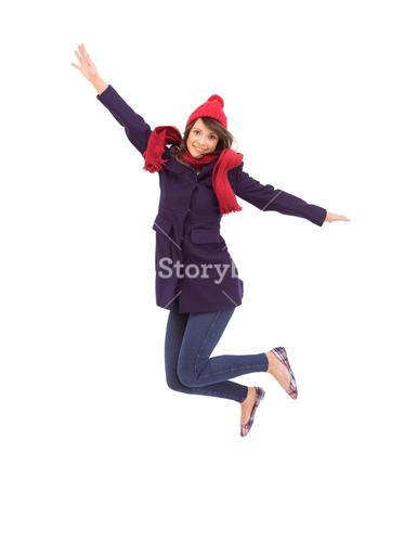 Woman in warm clothing jumping