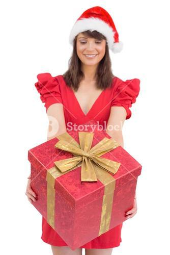 Festive brunette giving a gift