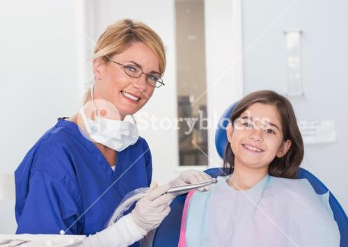 Portrait of a smiling pediatric dentist and young patient
