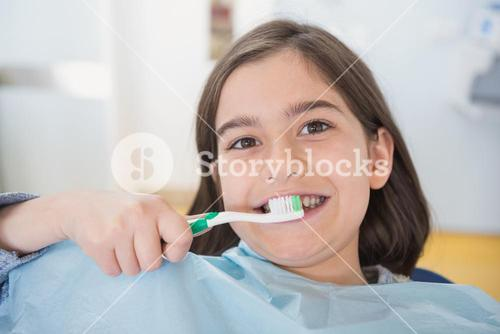 Smiling young patient holding touthbrush