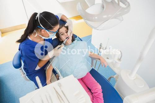High angle view of pediatric dentist examining her young patient