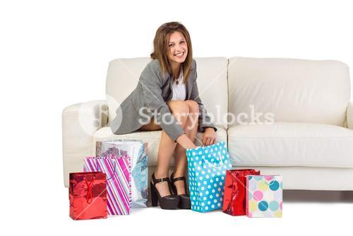 Happy brunette opening gift bag