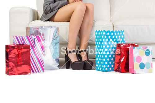 Woman with purchases and shopping bag on the floor