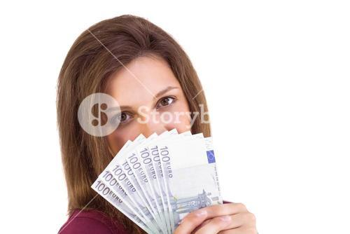 Festive brunette showing fan of euros