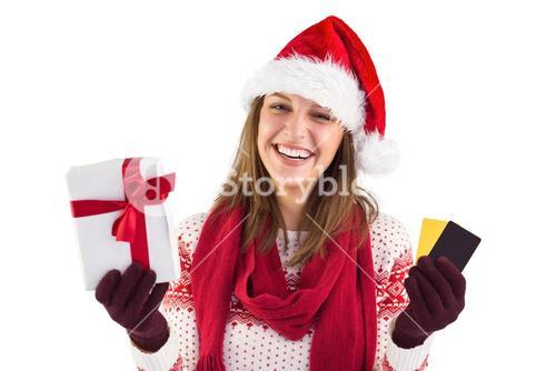Smiling young brunette with gift and credit card