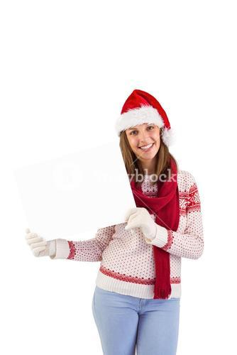 Happy brunette in winter clothes showing card