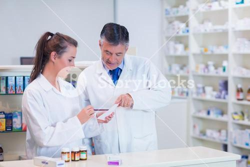Pharmacist and his trainee working together