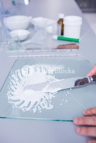 Close up of a biochemist making some medicine