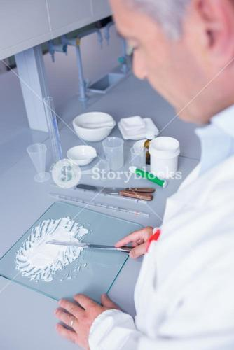 Biochemist standing while preparing some medicine