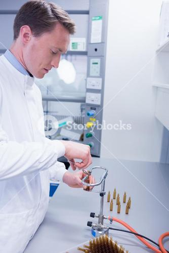 Focused biochemist sealing a vial