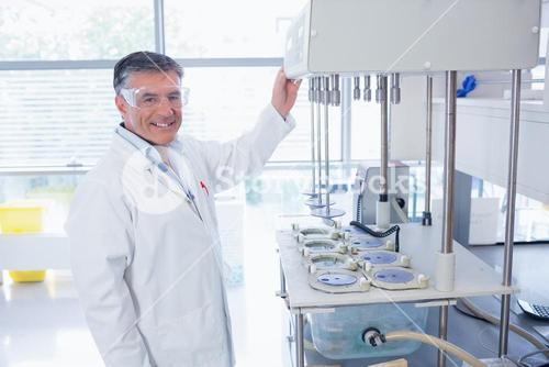 Smiling scientist with safety glasses