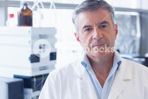 Portrait of an unsmiling scientist wearing lab coat