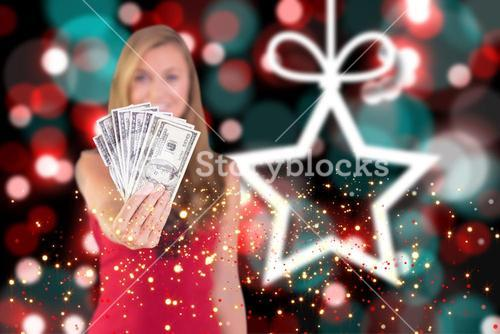Composite image of pretty blonde showing wad of cash