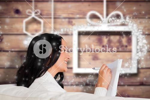 Composite image of woman writing down some notes