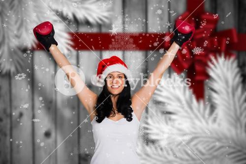 Composite image of woman wearing red boxing gloves