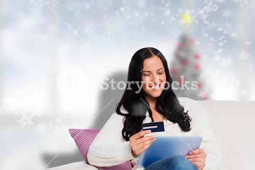 Composite image of woman sitting with tablet pc